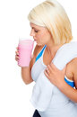 Protein shake woman gym drinking strawberry flavor Stock Photos