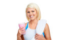 Protein shake woman gym drinking strawberry flavor Royalty Free Stock Photos