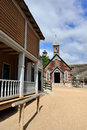 Protestant church street leading to old in wild west town Royalty Free Stock Photography