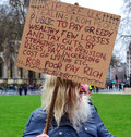 Protester london england older man protesting against government slavery and financial wealth held by a few privileged lady Stock Image