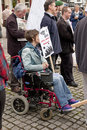 A protester in a wheel-chair holds Cuts placard Royalty Free Stock Photo