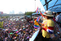 Protesters hold an anti government rally bangkok december on december at victory monument they blow whistles to make symbolic Stock Images