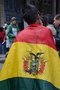 Protestor Wearing Bolivian Flag Royalty Free Stock Photography