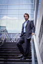 Proud Business man standing in front of his office Royalty Free Stock Photo