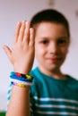 Proud kid showing friendship bracelets his Stock Photos