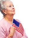 Proud old lady holding a flag of United States Stock Photography