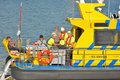 Proud sea men coming back from a job at the nord sea ostend belgium august unidentified on their yellow blue boat for services Stock Photo