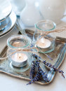 Provence style table setting dining at with candles lavender vintage crockery and cutlery closeup Royalty Free Stock Images