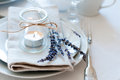 Provence style table setting dining at with candles lavender vintage crockery and cutlery closeup Royalty Free Stock Photography