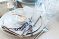Provence style table setting dining at with candles lavender vintage crockery and cutlery closeup Stock Photo
