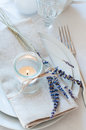 Provence style table setting dining at with candles lavender vintage crockery and cutlery closeup Stock Images