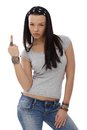 Provocative girl showing middle finger gesture young wearing spider ring Royalty Free Stock Photo