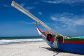 Prow of colorful Portuguese fishing boat with oar lifting skyward Stock Images