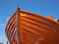 Prow of a wooden boat small with clear blue sky background Stock Photos