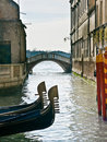 Prows of two gondolas in Venice Stock Photos