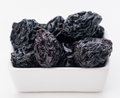 Prunes in small porcelain tray group of Stock Images
