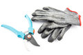 Pruning shears and gardening gloves worn isolated on white background Stock Image