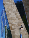 A psttern of building diagonals facade with stone and windows creating an interesting perspective diagonal lines reaching for the Stock Photo
