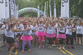 Psyched up color runners asheville north carolina usa july excited run participants wait impatiently at the starting line for the Stock Photo