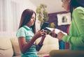 Psychiatrist diagnosing teenage girl with internet addiction Royalty Free Stock Photo