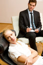 Psychiatrist examining a female patient Stock Photos