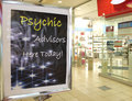 Psychic advisors sign in an urban mall Stock Photo