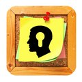 Psychological concept sticker on message board profile of head with a keyhole icon yellow cork Stock Photos