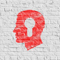 Psychological concept on white brick wall red profile of head with a keyhole icon grunge background seamless Royalty Free Stock Photography