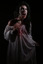 Psychotic bleeding woman in a horror themed image Royalty Free Stock Photos