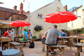 A pub garden people sitting out at tables enjoying drink in in the united kingdom this is at the kings arms in cromer united Royalty Free Stock Photos