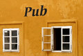 Pub windows in the old Royalty Free Stock Photos