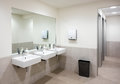 Public bathroom or restroom with hand basins Royalty Free Stock Photo
