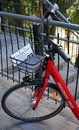 Public bicycle detail of front part and a basket. Sydney`s Reddy Go bike-sharing service offers bicycles for rent. Royalty Free Stock Photo