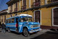 A public bus driving through the old town in La Paz in Bolivia. Royalty Free Stock Photo