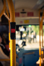 Public city bus transport inside and stop button detail Royalty Free Stock Images