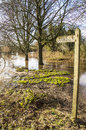 Public footpath sign, with flooded pathway Royalty Free Stock Image