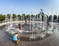 In the public fountain area have a refreshing bath new york usa july people at east harbor side late afternoon on july Stock Image
