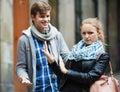 Public harassment man chasing irritated girl annoying men beautiful european Stock Image
