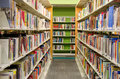 Public library interior of a showing hundreds of books on shelves Royalty Free Stock Images