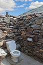 Public outdside stone restroom without roof at des Royalty Free Stock Photo