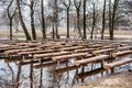 Public Park and Bench on the Water. Early Spring Time. Lithuania, Siauliai. Royalty Free Stock Photo