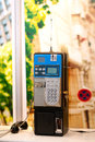 Public phone a blue and black Royalty Free Stock Photography