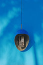 Public phone on blue wall background cute oval in cienfuegos cuba bright Stock Photos