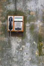 Public phone on grunge wall Stock Photo