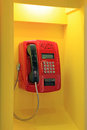 Public phone red telephone in the yellow booth with lighting Royalty Free Stock Image