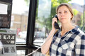 Public phone young woman making a call at a box Royalty Free Stock Photography