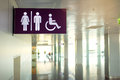 Public restroom signs toilets icon with a disabled access symbol interior of airport terminal Stock Photos