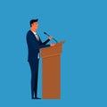 Public Speaker. Businessman speaking on podium giving public speech. Royalty Free Stock Photo