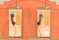 Public telephone old coin on wood wall Stock Images