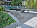 Public urban space design in central tokyo japan forniture downtown wood seating bench Royalty Free Stock Photo